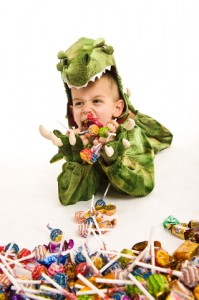 Boy in Halloween Costume with Candy