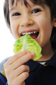 boy eating salad