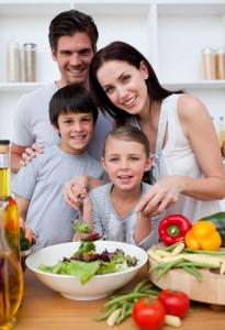 Family making healthy dinner together