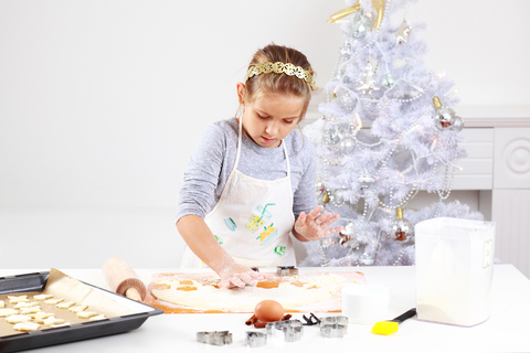 girl baking christmas cookies