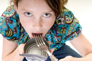 girl eating from empty can