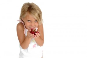 girl holding grapes