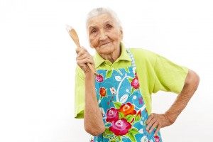 old woman with cooking spoon